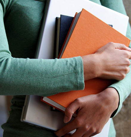 Photo of a student holding books.