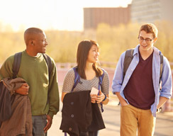 Photo of three students walking and talking.