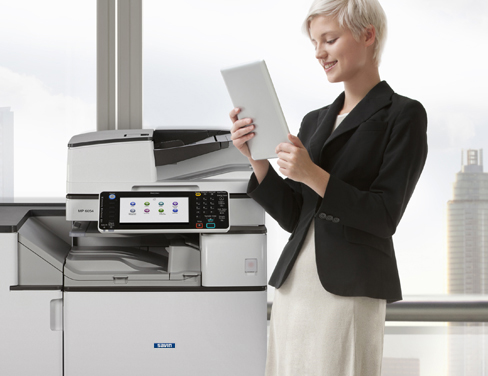 Woman using a Savin printer.