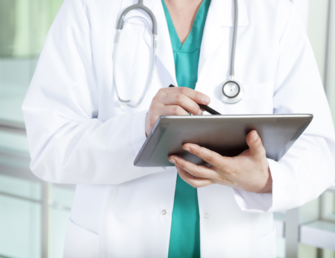Photo of a doctor reviewing data on a tablet