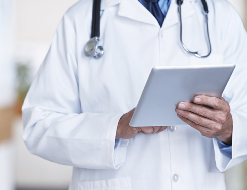 Doctor using a tablet device.