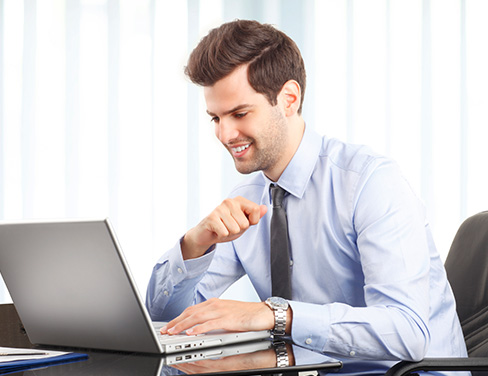 Worker at desk on a laptop