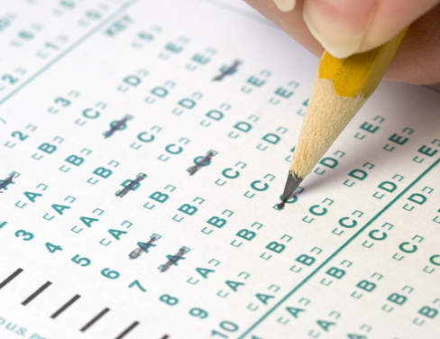 Close up of a pencil filling out a multiple choice test