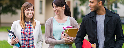 Three students walking together on campus