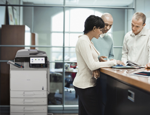 Office workers printing documents