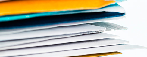 Closeup of stacks of mail