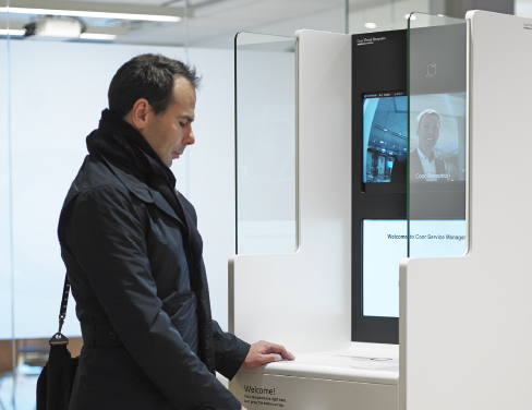 Man in coat checking in at Virtual Reception